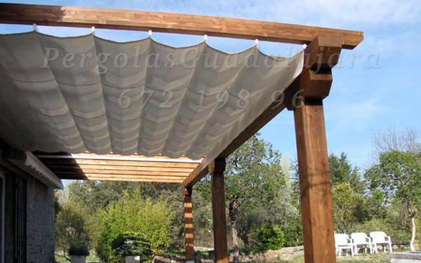 Toldos para p rgolas de madera en madrid y guadalajara for Roldanas para toldos